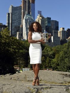 Serena Williams in Central Park with her US Open trophy.