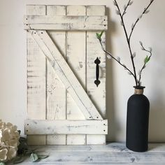THIS LISTING IS ONE DOOR IN FOR THE LARGEST SIZE WE OFFER: 14 X 24. (sizes can vary by 1/4 depending on wood used). To see all our barn door options: https://www.etsy.com/shop/ElevenOwlsStudio?ref=hdr_shop_menu§ion_id=18338384 These mini barn doors are a great addition to a rustic gallery wall or as a backdrop for wreaths, photographs, bouquets or whatever...the possibilities are limitless! Barn doors are perfect for a foyer, a living or family room, a bedroom or anywhere you want a touch of…