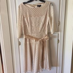 Tahari cream lace dress Beautiful Tahari cream lace dress. Only worn once, in perfect condition. Fully lined with lace overlay and sleeves and a satin ribbon belt. Size 8. This is a gorgeous dress! Tahari Dresses Midi