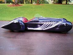 Blastolene B-702  French curve car design ala 1930 Delahaye called the B702 . It has a hand formed aluminum body is finished in a dark blue with a Maroon leather interior. A GMC 702 cu.in. V12 and an Allison 4 speed automatic for power.