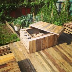 Pallet table with removeable lid which reveals firepit beneath