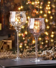Fill this dazzling chalice with the candle of your choice and delight in the dancing glow of the flame from behind the golden speckled design atop the elegant long stem. This tall chalice will help you set the scene for a romantic dinner or cozy n...