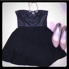 Strapless fit and flare dress with Leather Bust Selling a beautiful black mini dress with a leather bust and chiffon skirt. Dress has very cute cut out detailing on the back, and works great for any formal occasion. 13 inch waist and   15 1/2 in across the bust although both parts have a lot of stretch in them. 26 1/2 in length. Willing to negotiate, use the offer button! Olivaceous  Dresses Mini