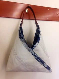 A Recycled Sail Cloth Bento Bag from Calypso ReCreations.  This bag is made with a recycled mainsail, a recycled shower curtain, and Latigo leather handles.
