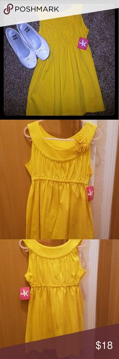 Yellow girls dress Brand new yellow girls dress very cute would fit girls size 5-7 my daughter his this dr4sd in 3 colors and even when it get too short it is super cute with leggings underneath! J.Khaki Dresses
