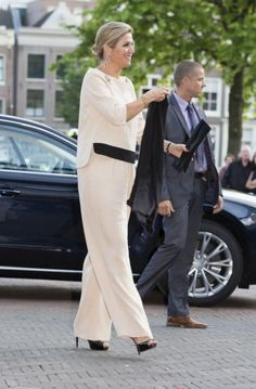 The queen in a jumpsuit by Natan. Click on the image to see more looks.
