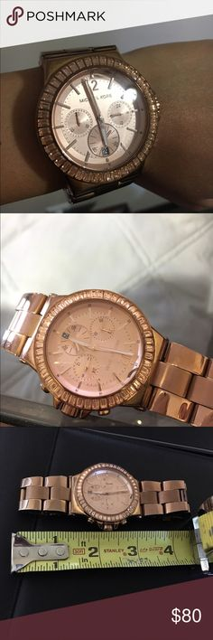 Michael Kors Dylan Chronograph Watch MK5412 Rose gold men inspired design watch with 46 clear stones surrounding the dial chronograph function Date display. Perfect for daily wear or to dress it up for a night out of town. There is a slight crack on the watch, refer to picture. Not really noticeable unless you really look for it. Original box and extra links are not included Michael Kors Accessories Watches