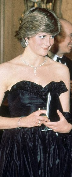 Diana continued to be a staunch supporter of Emanuel, wearing the label for her first public engagement, left and at a ball in Melbourne Australia in 1985, right