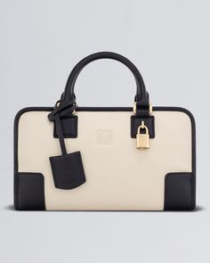 """Loewe amazona: Spain's premiere luxury brand Loewe was founded in 1846, and in 1975, they launched the first flexible, unboxy handbag in sporty, unlined suede, which quickly became iconic in Spain, and then around the world. Named """"Amazona"""" to signify female strength, each bag is rumoured to take 10-12 hours to create, and it comes in a variety of playfully bright hues. Madonna, Jennifer Lopez and Sienne Miller are fans."""