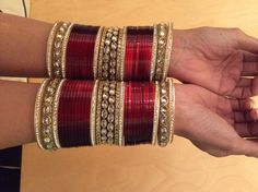 A Choora is a set of bangles that are usually red & white & are worn by a bride on her wedding day.Here are few choora styles for brides in trend nowadays. Indian Accessories, Bridal Accessories, Bridal Chura, Wedding Chura, Bridal Bangles, Bangle Set, Wedding Jewelry Sets, Silver Bracelets, Thread Bangles