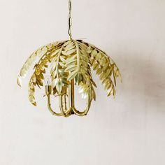 A tropical inspired statement chandelier, handcrafted from brass-plated metal. Statement Chandeliers, Mirror Table, Ceiling Lights, Gold Table, Palm, Decorative Pendant Lighting, Brass Floor Lamp, Marble Side Tables, Handmade Natural