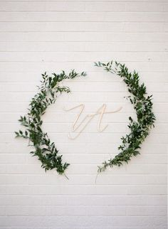 leaf swag and script monogram - photo by http://www.erinjsaldana.com/ - http://ruffledblog.com/romantic-organic-wedding-at-elysian-la | Ruffled