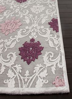 I really like the floral pattern of this rug with the purple, pink, and grey colour scheme. It also has a soft yet rough texture that looks very comfortable to walk on.