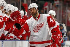 """Todd Bertuzzi. #44 LW. Born in Sudbury ONT in 1975. Drafted 1st R by NYI, traded to Vancouver in 97/98.  6'3"""" 235.  Rugged, hard nose controversial player. Joined Detroit late in 2007 season from FL; returned to DRW for 2009/2010. +"""