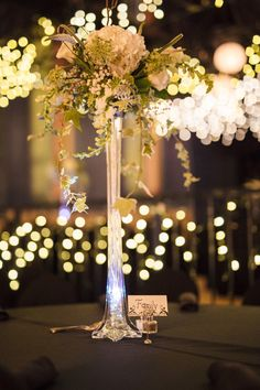 Table center pice...White. Eiffel Tower vase tops. Hydrangea, Veronica, snapdragons, roses, variegated ivy, Queen Ann's Lace, tulips