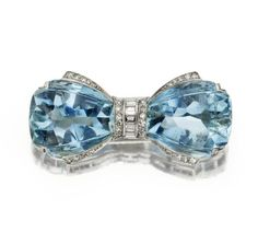 Diamond and Aquamarine bow brooch, designed as a bow with fancy-shaped aquamarine terminals, decorated with single-cut and baguette diamonds, circa 1935