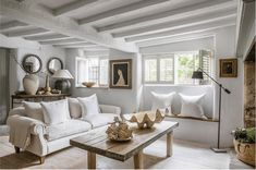This beamed cottage has been modernised with new floors and a fresh neutral colour palette. To add more modernity to the space, they have also painted the beams to avoid the heavy-ceilinged feel you can sometimes get in an old cottage. Image: Anton & K. Interior Simple, Modern Interior Design, Contemporary Design, Contemporary Cottage, Cottage Living Rooms, Home And Living, Cottage Living Room Decor, Modern Cottage Decor, Cottage Lounge