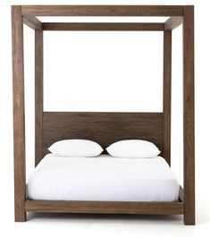 0eca43b72f9 A simple four-poster canopy bedframe in solid oak makes an elegant  statement. We
