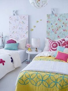Floral Wallpapered Headboards in Girl's Room - love wallpaper in surprising places! Colors are awesome too. Would be perfect in the sisters' bedroom
