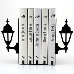 """Images of the lamp posts of the past. The kind you see on old photographs... WANT. LIKE. NOW !!! One of a kind contemporary style bookends for your meaning of reading in our lives. Powder coated laser cut metal. One piece measures 5""""9 by 4""""3 with base ..."""