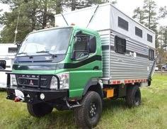 Four Wheel Pop-Up Campers offers a variety of pop-up campers for pickup trucks and also built this custom camper for a Mitsubishi Fuso Camper Caravan, Popup Camper, Truck Camper, Camper Trailers, Travel Trailers, Off Road Bumpers, Big Trucks, Pickup Trucks, Slide In Camper