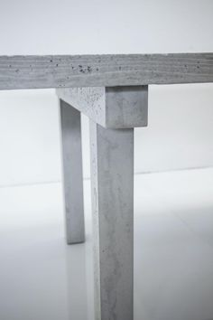 Concrete table, Concrete by LCDA.  Made from a rigid honeycomb core coated with a 10-mm layer of ultra  high-performance fibrereinforced  concrete thanks to an exclusive moulding system. This technique makes  it possible to achieve a weight  (80 kg) that is 4 times lighter  than a traditional structure