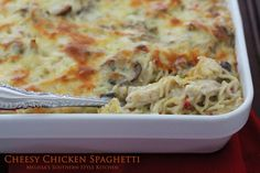 Cheesy Chicken Spaghetti with a creamy dreamy homemade white sauce. The perfect dish and it's company worthy!