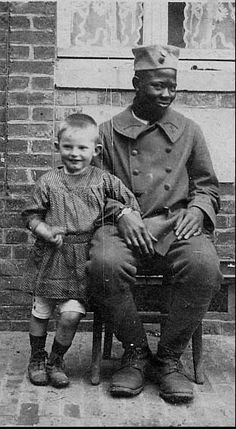 Tirailleur Sénégalais with a French child. Somme, 1916. They were taught a patois French, but many picked up excellent language skills in the war.
