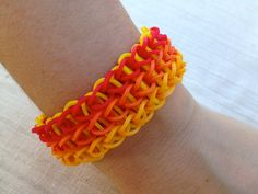 Rainbow Loom bracelet made from rubber bands, red, orange and yellow bands.