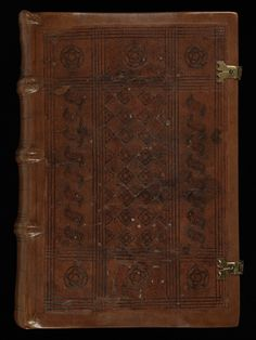 A leather manuscript cover with two metal locks. It's decorated with carved pattern #manuscript #bookcovers #illuminations #books #middleage #medieval