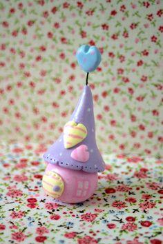Tiny fairy figurine with fairy house