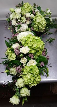A two-piece corner flower arrangement for a wedding arch in shades of white and . - A two-piece corner flower arrangement for a wedding arch in shades of white and green with pink acc - Funeral Flower Arrangements, Funeral Flowers, Red Bouquet Wedding, Wedding Flowers, Wedding Dress, Wood Wedding Arches, Casket Sprays, Seasonal Celebration, Cemetery Flowers