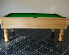 7ft Emperor UK Pool Table manufactured in European oak with a natural satin finish and tulip / fluted legs. Shop here: http://www.snookerandpooltablecompany.com/pool-tables/uk-pool-tables/traditional-bespoke-uk-pool/emperor-uk-pool-table-in-oak-with-green-cloth.html