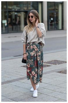 20 Spring Outfits Women With Sneakers And we've got you covered in the inspiration department. These 20 spring outfits women with sneakers will have you ever ever wishing for the flowers to bloom. Let's check out some trending looks. Floral Skirt Outfits, Midi Skirt Outfit, Casual Skirt Outfits, Modest Outfits, Modest Fashion, Skirt Fashion, Overalls Outfit, Casual Ootd, Diy Outfits