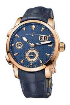 Ulysse Nardin's Dual Time Manufacture in a 42mm 18krg case with a blue dial. Features a self-winding movement, big date, and a quick setting GMT. Oster Jewelers Is An Authorized Ulysse Nardin Retailer