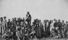 Little Bear (standing above the group) with the remnants of Big Bear's Band in Havre, Montana - Cree - 1896
