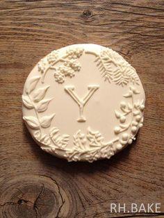 Botanical white on white initial cookie