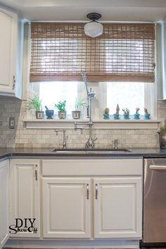 light above the sink ?? modern, vintage, eclectic farmhouse kitchen makeover at diyshowoff.com