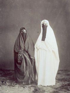 Full-length portrait of two Arab women in traditional dress