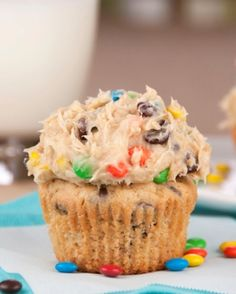 Monster Cookie Dough Cupcakes are rich peanut butter cupcakes topped with a sweet and loaded cookie dough frosting packed full with peanut butter, chocolate chips and MM candy! This is the best cupcake recipe ever!