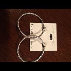 Silver hoop earrings new with tags. Silver hoop earrings with tags on.  From Stein mart. Steinmart Jewelry Earrings