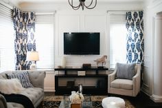 Classic blue curtains add a pop of color to an airy, neutral room