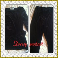 Velour pantsuit Very comfortable set made of 90% polyester & 10% spandex (in other words black velour). Definitely stretchy.  Top has a scoop neck, attached decorative belt on front, and hits below waist area.  Pants are simple with elastic waist and wider legs.  Perfect for a dressy occasion when you just don't feel like wearing a dress!  Size is 10 and its true to size.  No flaws.  Brand name is Dani Max. Dresses