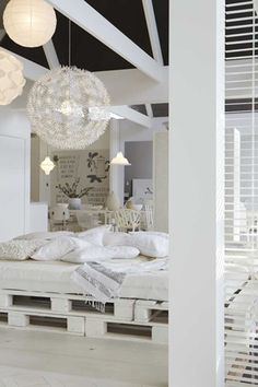 Pallets, covered with a pile of pillows and plenty of different lamps. Sounds risky, but looks impressively good