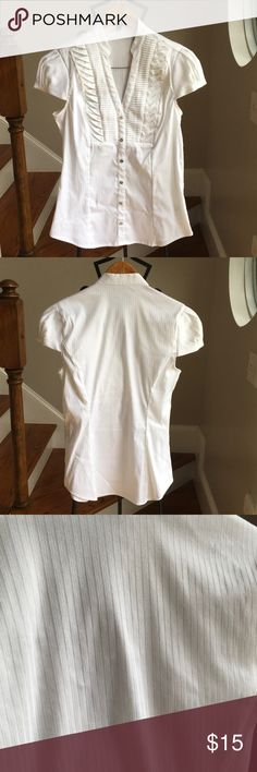 White Express Blouse In great used condition no stains or flaws. Has side zip closure. Buttons do not come undone. Express Tops Blouses