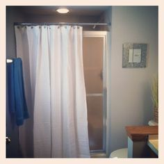 Shower curtain to cover up ugly glass shower doors Bathrooms