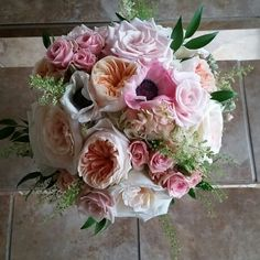 English garden inspired bouquet of David Austin Juliette garden roses, white O'Hara garden roses, sweet Akio roses, pink spray roses, anemones and touches of stock, ruscus and penny crest by Eden's Echo