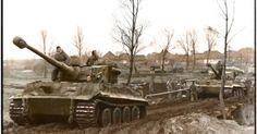 Several Tiger 1 tanks of 1st Waffen SS Pz.Div. on the march.