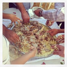 Mansaf, Jordan's national dish!  It's eaten with the hands traditionally.  Rice, lamb, jameed (a yogurt gravy), & toasted almonds or pinenuts.  Delicious!