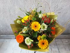A bright and vibrant floral handtie bouquet in yellows, oranges, reds and whites with a hint of gold. Bouquets, Red And White, Floral Wreath, Vibrant, Bright, Wreaths, Seasons, Flowers, Gold